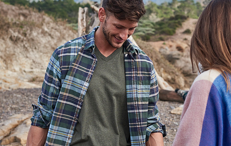 Man in a flannel shirt on the beach