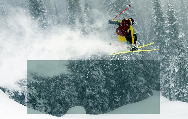 Airborne skier in a snowy landscape