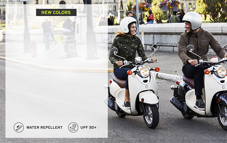 Two people on mopeds wearing Atlas II jackets