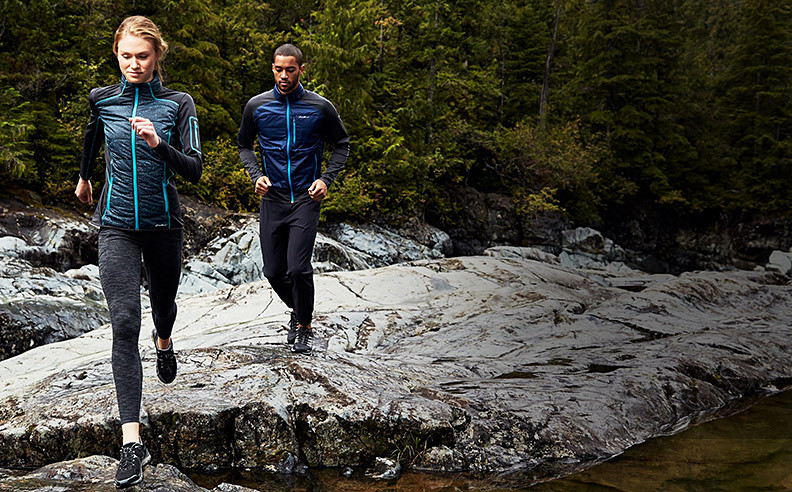 Two people trail running in training apparel