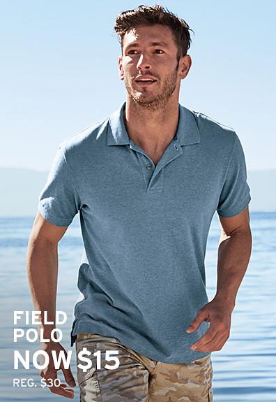 A man wearing a Resolution T-Shirt runs on the beach
