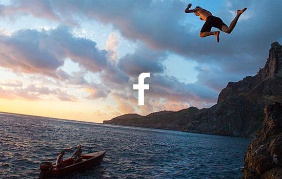 Image of a man jumping off a cliff into the water