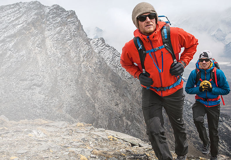 Cory Richards and Adrian Ballinger hiking near basecamp on Everest