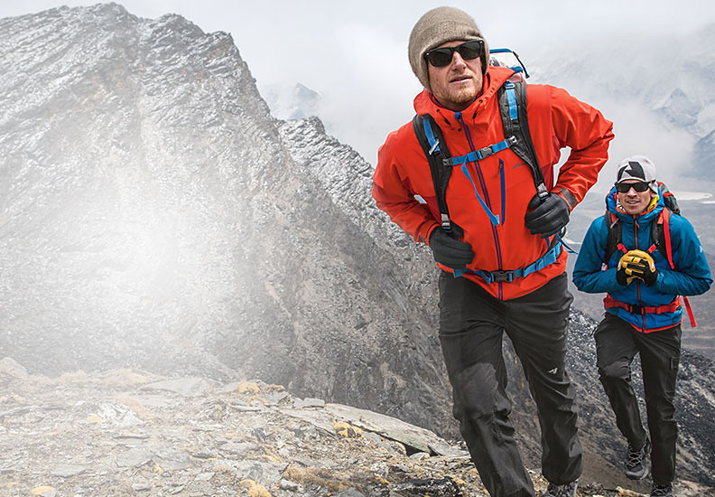 Eddie Bauer climbing athlete Cory Richards and alpine guide Adrian Ballinger hiking near basecamp on Everest