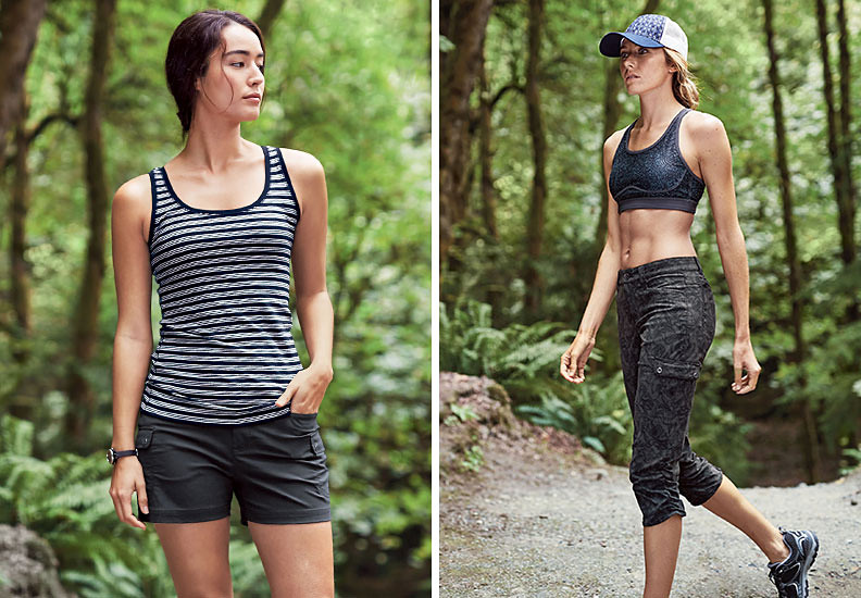 Two women wearing Horizon Cargo Shorts and Capris hikes in the woods