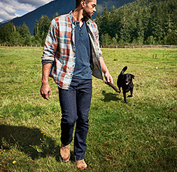 Image of a man walking with a dog
