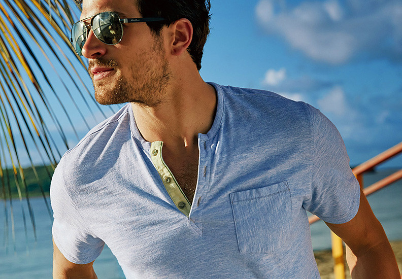 Image of a man wearing a henley shirt and sunglasses