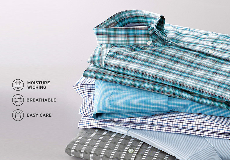 A stack of wrinkle free shirts in different colors and patterns