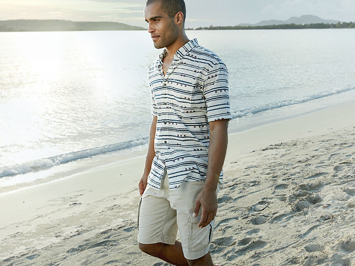 Image of a man wearing Exploration Cargo Shorts on the beach
