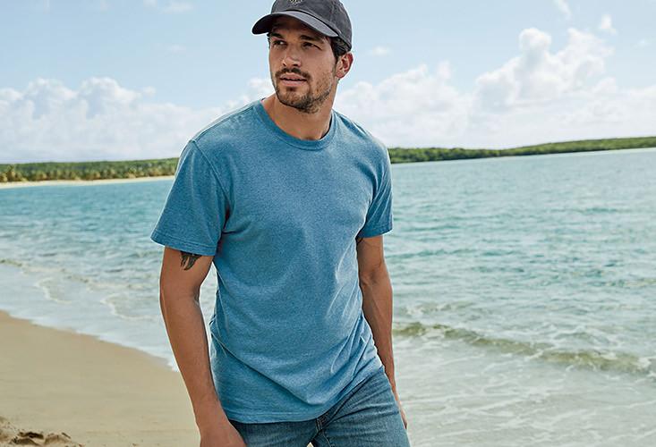 A man wearing a Legend Wash T-shirt