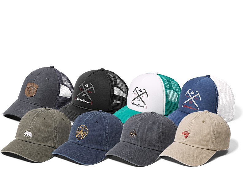 A variety of hats with different designs and logos