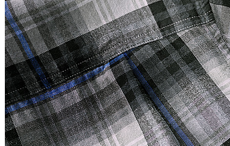 Background image of a plaid flannel shirt