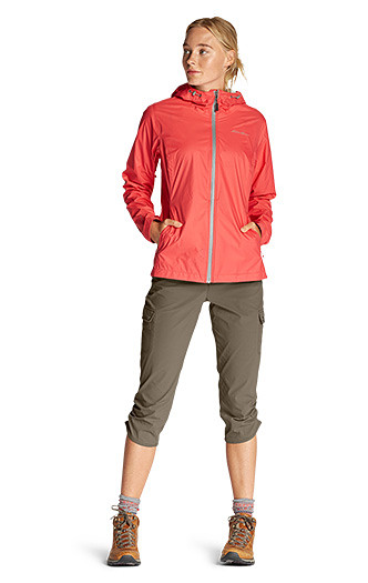 A women wearing Horizon Capris with a Cloud Cap Rain Jacket