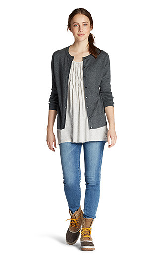 A woman wearing a Christine Cardigan with jeans
