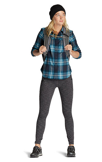 A woman wearing Expedition Flannel with Trail Tights