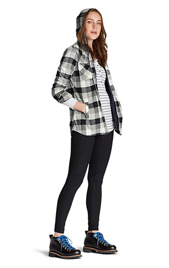 A woman wearing a Stine's Favorite Flannel Hooded Shirt Jacket with Trail Tights
