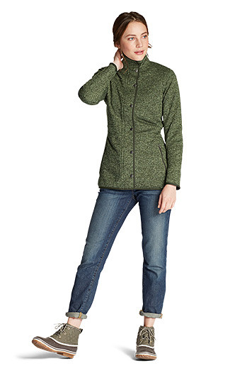 A woman wearing a Radiator Fleece jacket with jeans