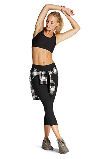 A women wear Trail Tights with a Sports Bra and a flannel shirt wrapped around her waist