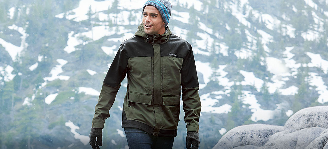 A man wearing the Chopper Jacket walks in the mountains