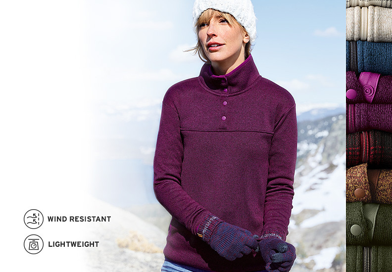 A women in a Radiator Fleece Pullover stands in front of snow-capped mountians