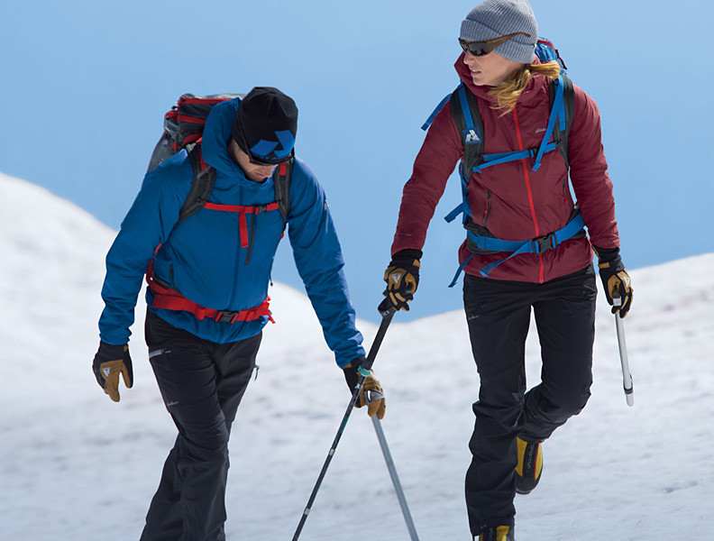 Eddie Bauer alpine climbing guide Melissa Arnot and climbing athlete Cory Richards wearing EverTherm Jackets