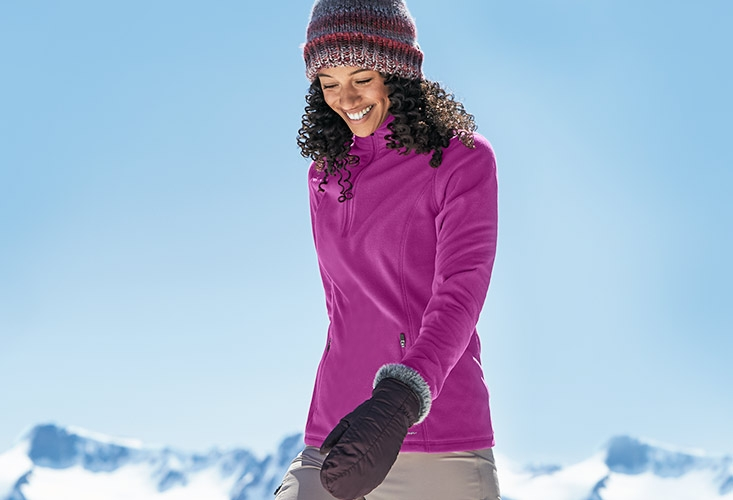 A woman wearing a Quest Fleece pullover