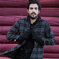 A man wearing a flannel shirt
