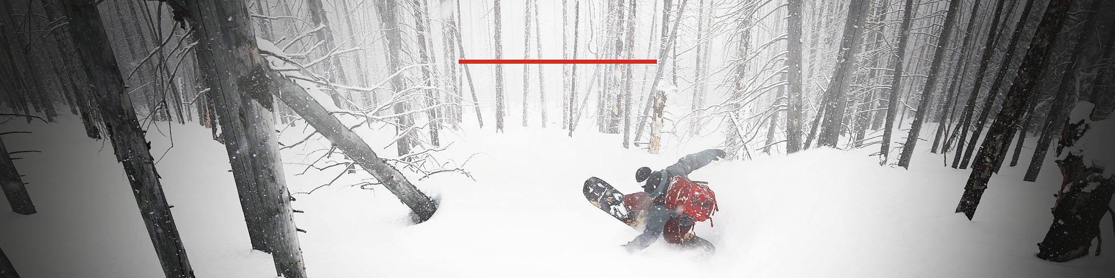Eddie Bauer snowboard guide Chris Coulter shredding fresh pow in the Monashees, BC