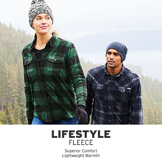 A man and a woman hiking in Chutes Microfleece Shirts