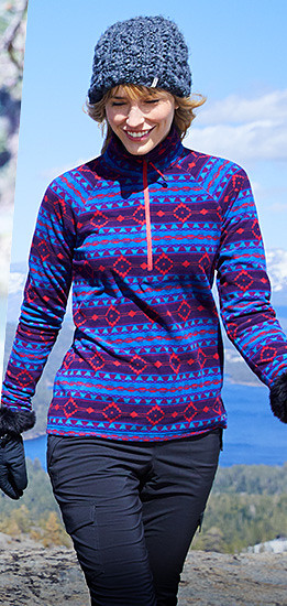 A woman wearing a printed Quest Fleece Pullover