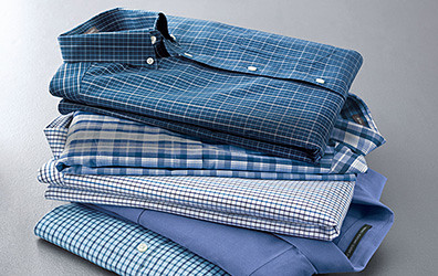 A stack of shirts in different colors and patterns