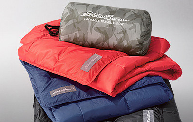 Stack of packable down throws