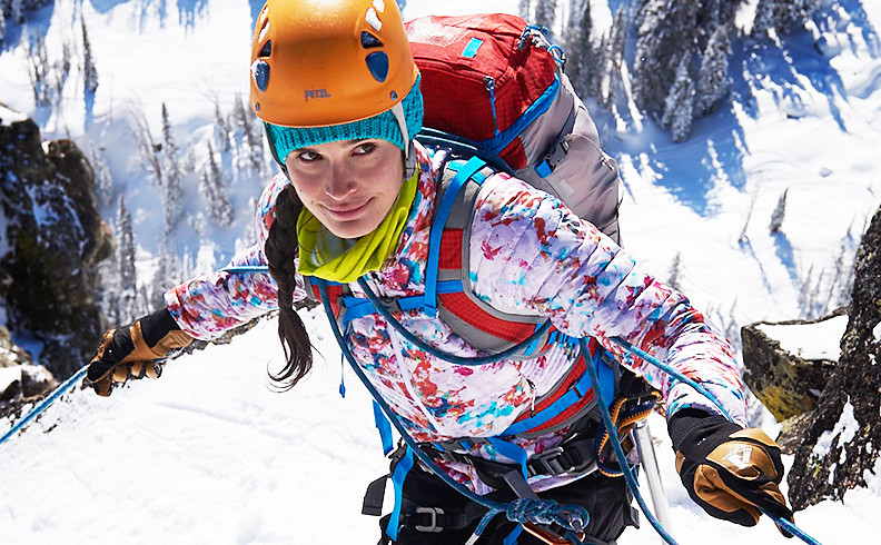 A woman wearing a MicroTherm Jacket climbs in the mountains near Jackson Hole, WY