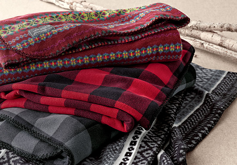 Stack of fleece throws, showing different colors and patterns