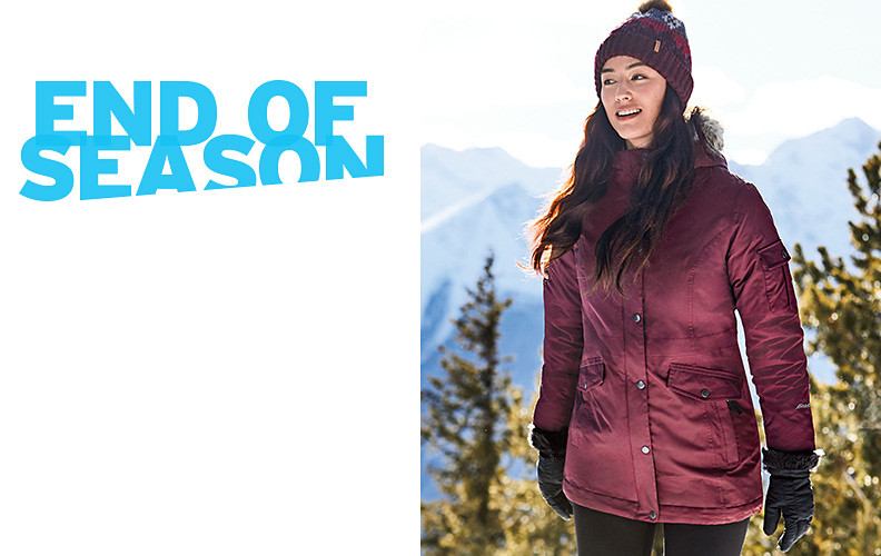 A women wearing a Superior 3.0 Down Parka walks in a winter landscape