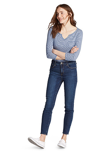 A woman wearing Elysian Skinny High Rise Jeans