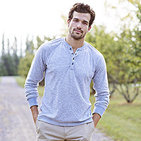A man wearing a henley