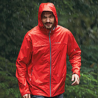 A man wearing a Cloud Cap Rain Jacket