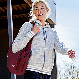 A woman carrying a Zen tote