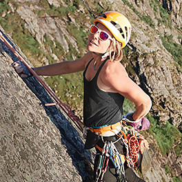 Eddie Bauer alpine guide Caroline George rock climbing in a Resolution Tank Top