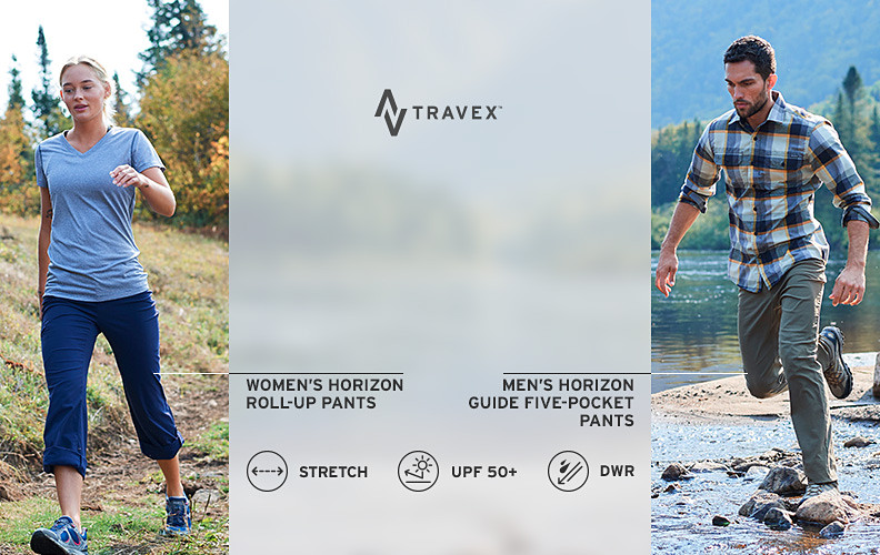 A man and a woman hiking in Horizon pants