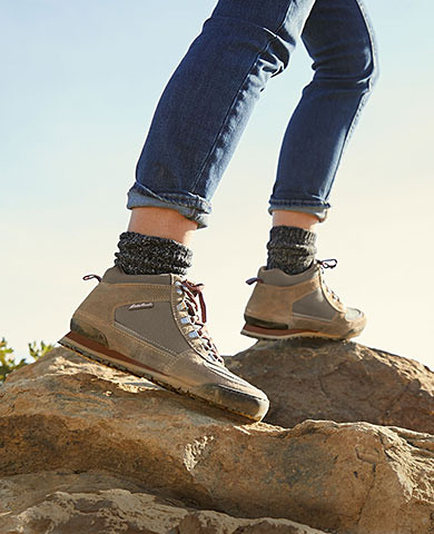 A woman hiking in the highland sneaker boot