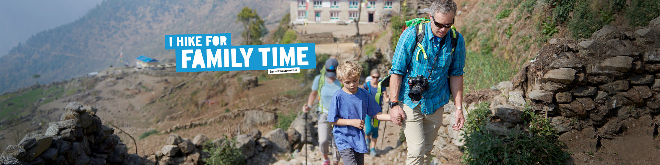Eddie Bauer alpine guide Jake Norton walks hand in hand with his son in Nepal