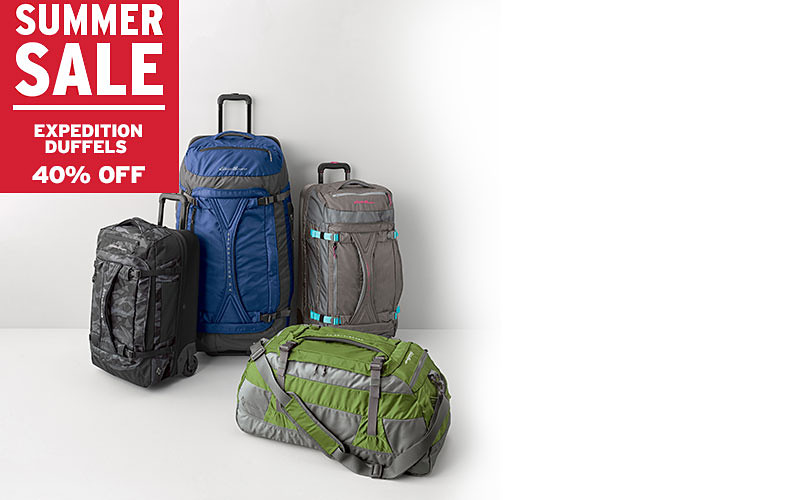 Different styles and colors of rolling duffels and luggage