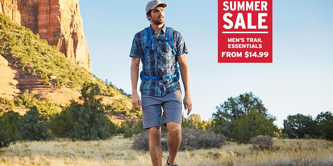 A man wearing Horizon Guide Chino Shorts hikes in the desert