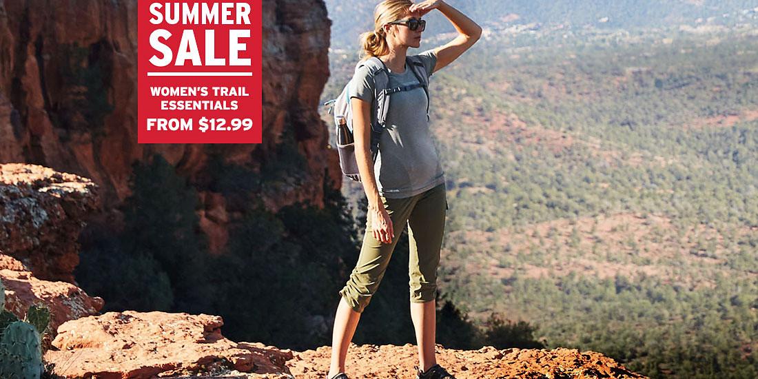 A woman wearing Horizon Capris hikes in the desert