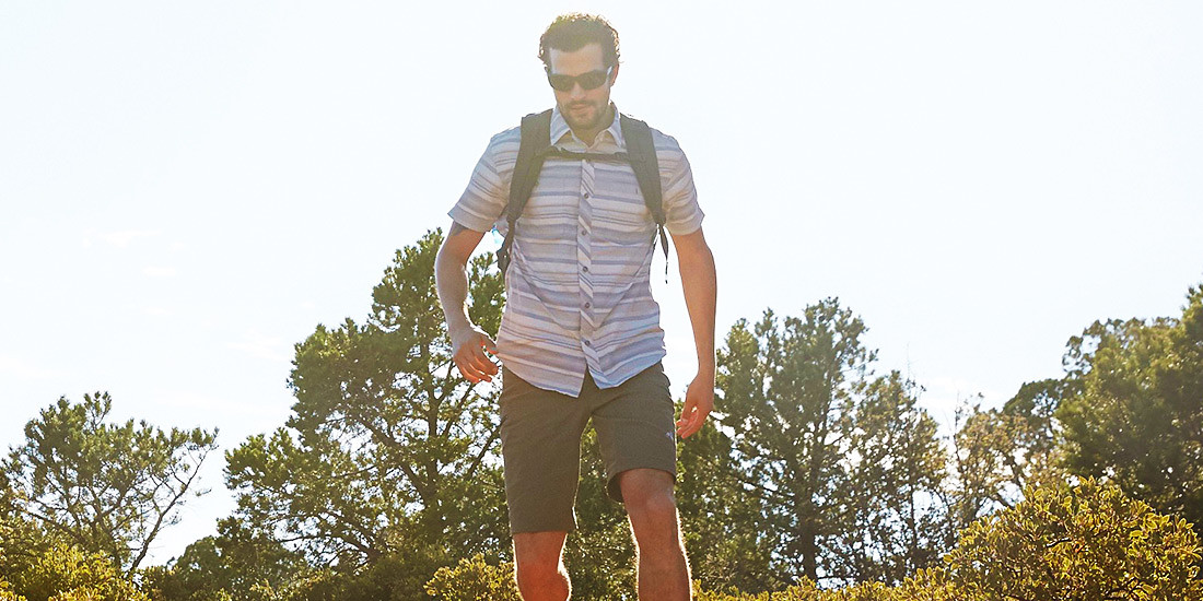 A man hiking in a Greenpoint Shirt