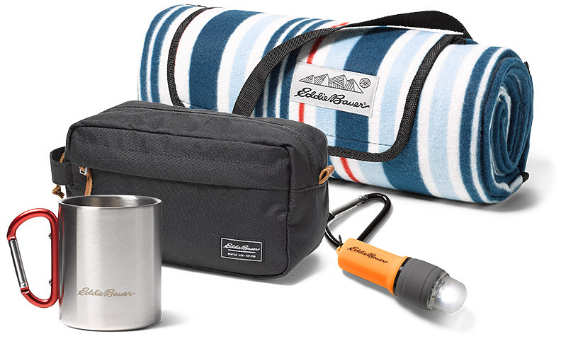 An assortment of small travel and gear items and water bottles