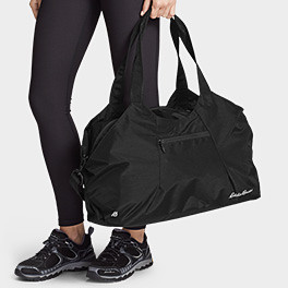 Image of person carrying fitness/travel tote
