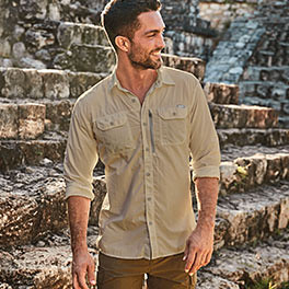 Image of man in an Exploration shirt